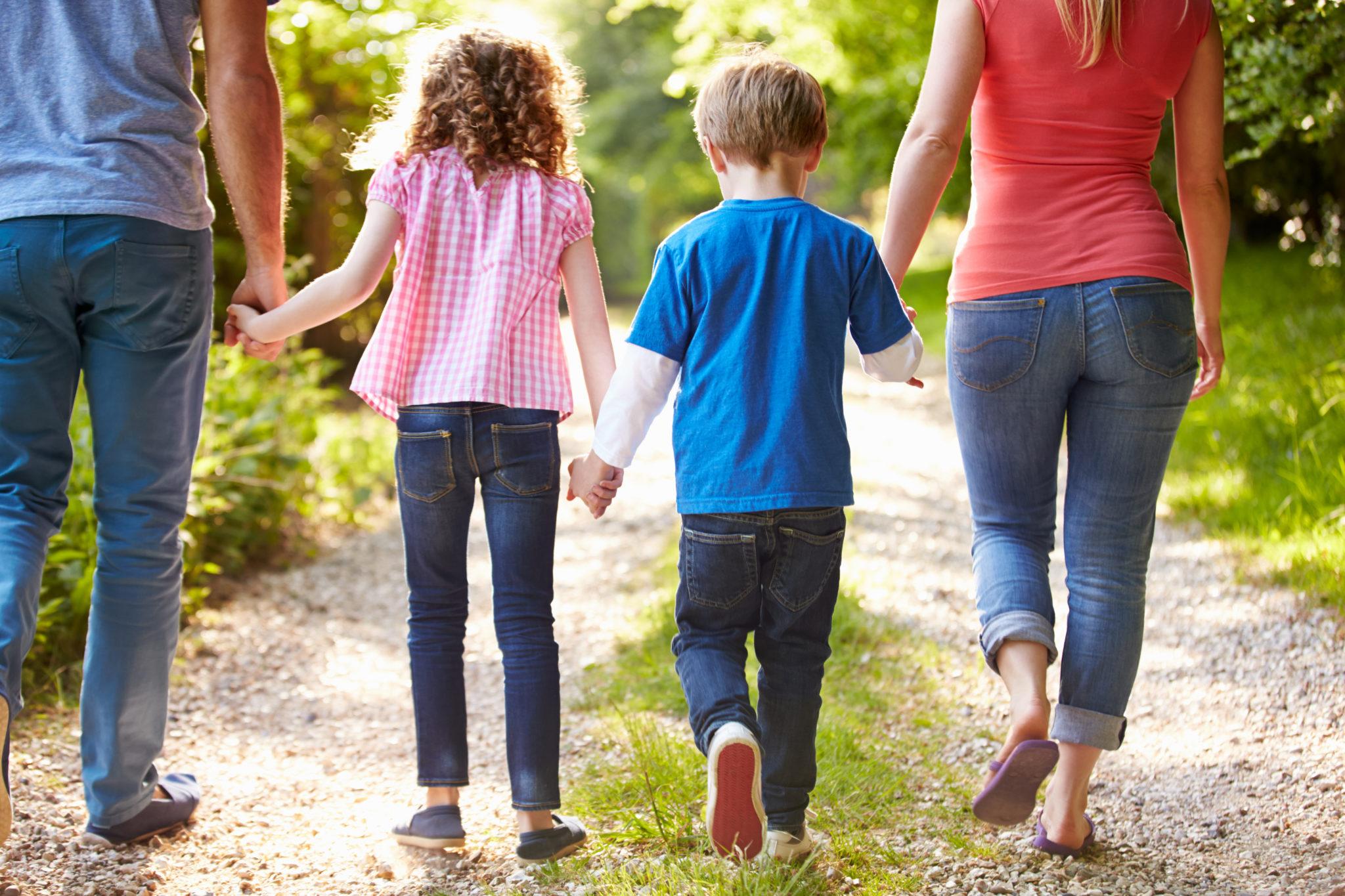 Family walking down trail