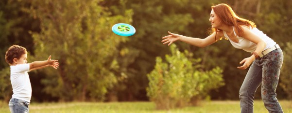 Mom Throwing Frisbee To Child