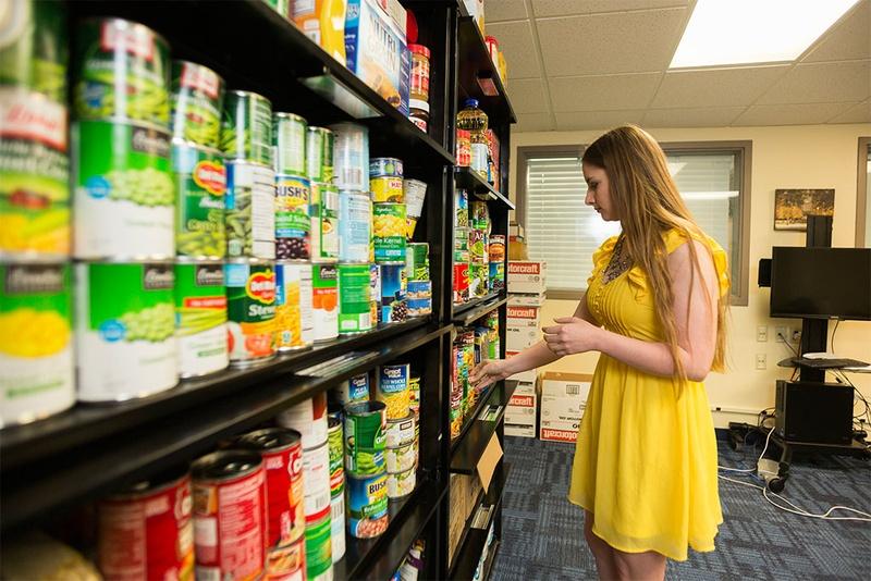 Woman choosing food at food pantry