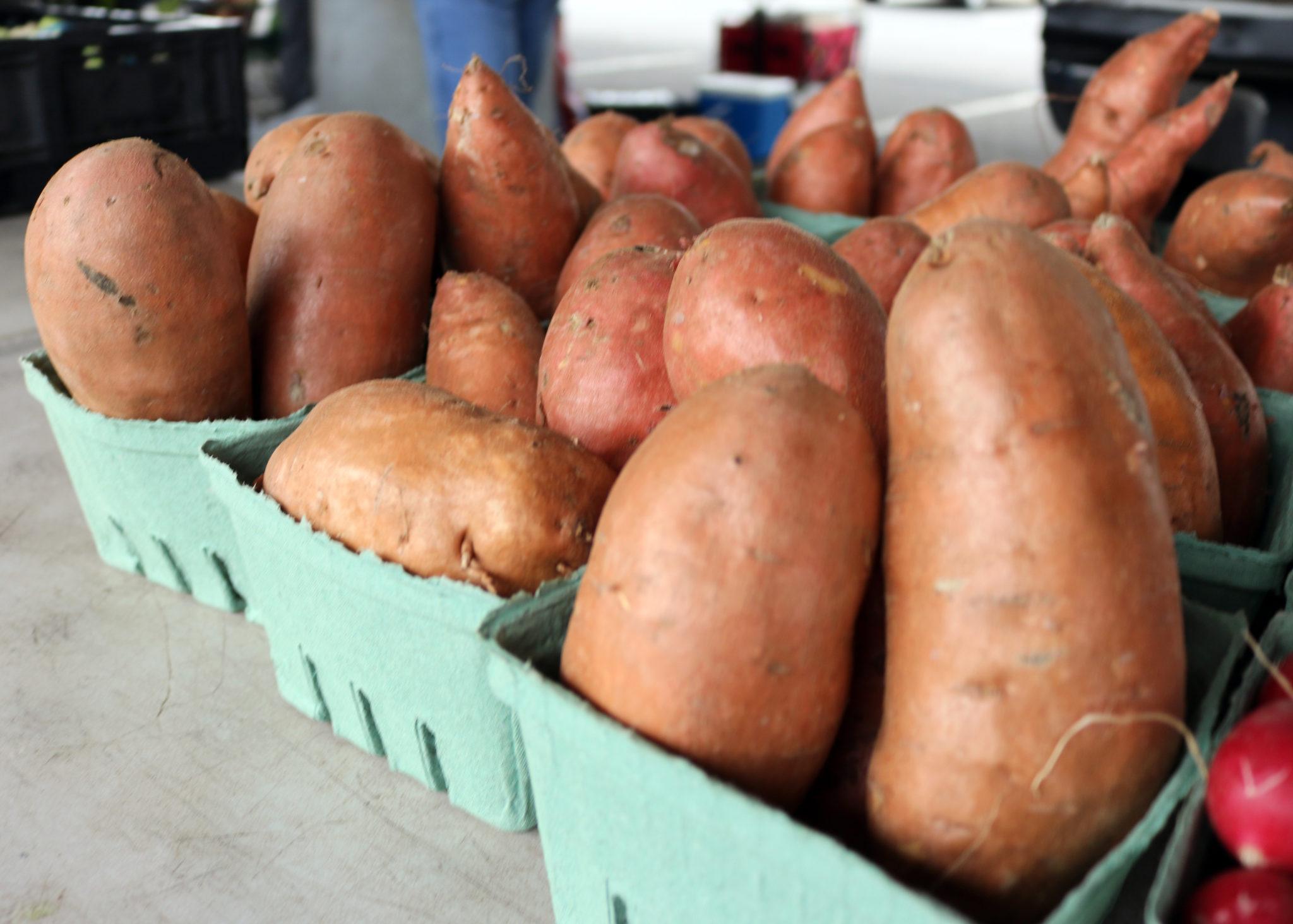 Baskets of sweet potatoes at market