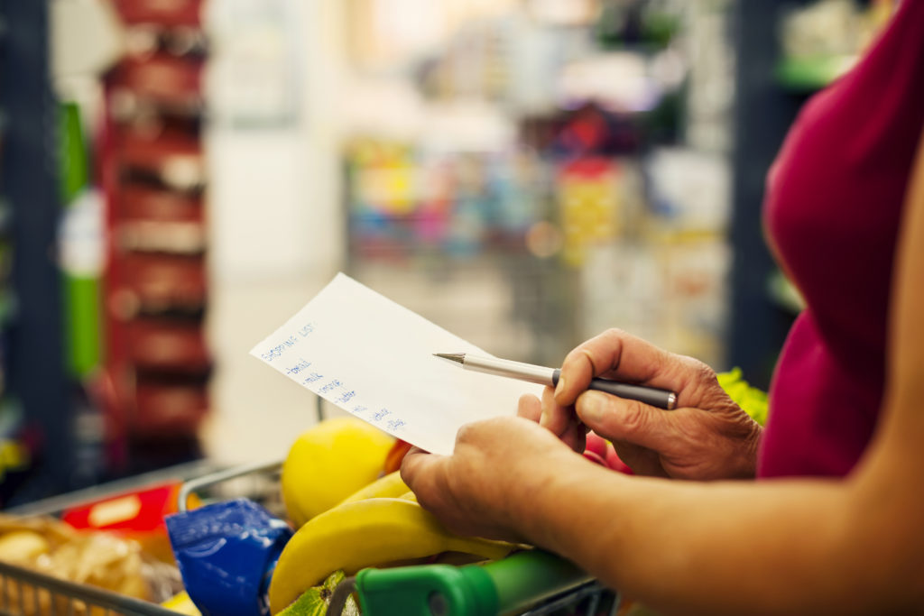 person with shopping list